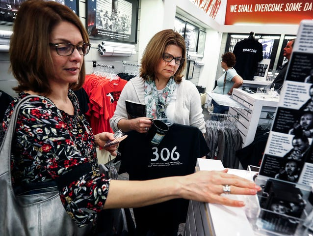 "During a trip to the National Civil Rights Museum, twin-sisters Tracy Bouslog (cq) (left) and Terri Fisher-Reed (right) look over MLK50 merchandise, including a ""306"" t-shirt, which signifies the room Dr. Martin Luther King Jr., was staying-in when he was killed outside the Lorraine Motel. The sister, both from St. Louis, who were born in October of 1968, felt compelled to visit Memphis this week."