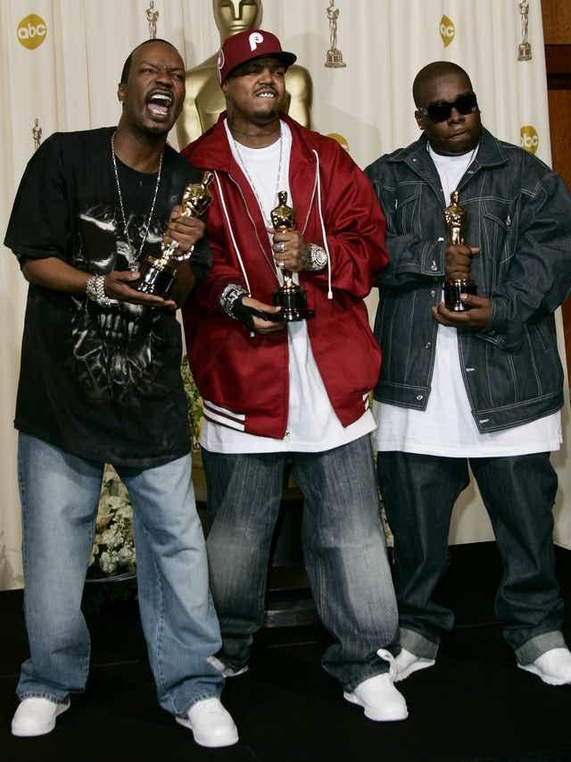 Three 6 Mafia accepting their Oscar in 2006.