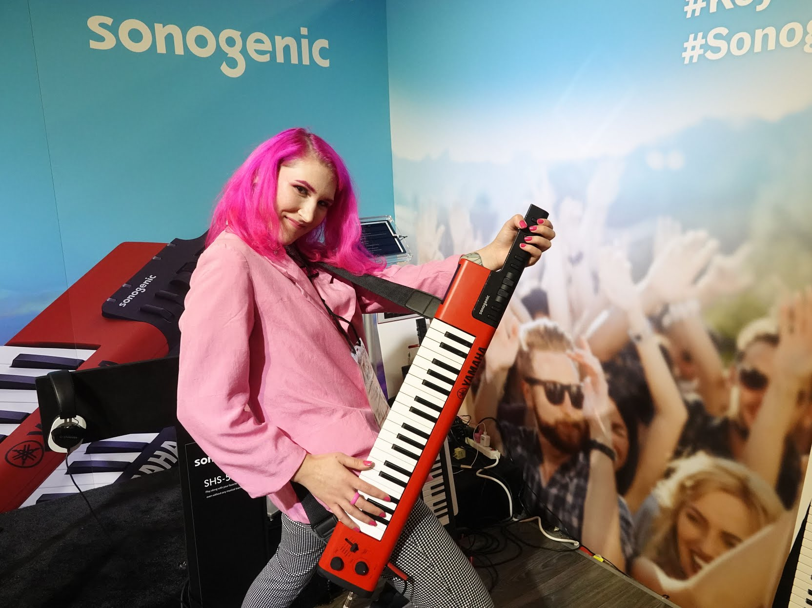"""The singer/songwriterPLASMICdemonstrates the Yamaha Sonogenic """"Keytar"""", a $299 keyboartd for young people who don't know how to play. Software enables users to play along with songs in key; they can also play normal piano as well."""