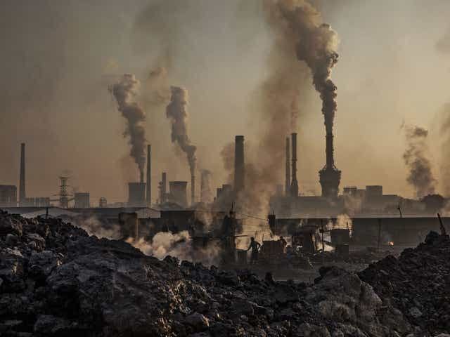 Smoke billows from a large steel plant on November 4, 2016 in Inner Mongolia, China. Over the industrial era, the amount of carbon dioxide in the atmosphere has increased by about 40%, according to the U.S. Global Change Research Program.