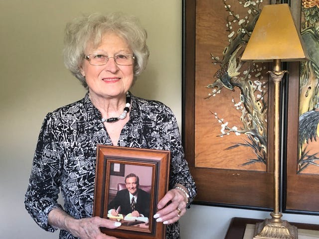 Joyce Rogers holds a photo of her late husband Adrian Rogers, who was a key leader in the Southern Baptist Convention's conservative resurgence.